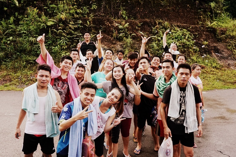 A group of local students on their way to the waterfall with Backyard Tour Malaysia