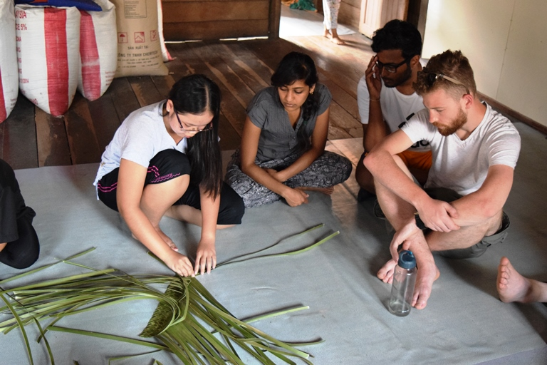 A group of student learning how to weave