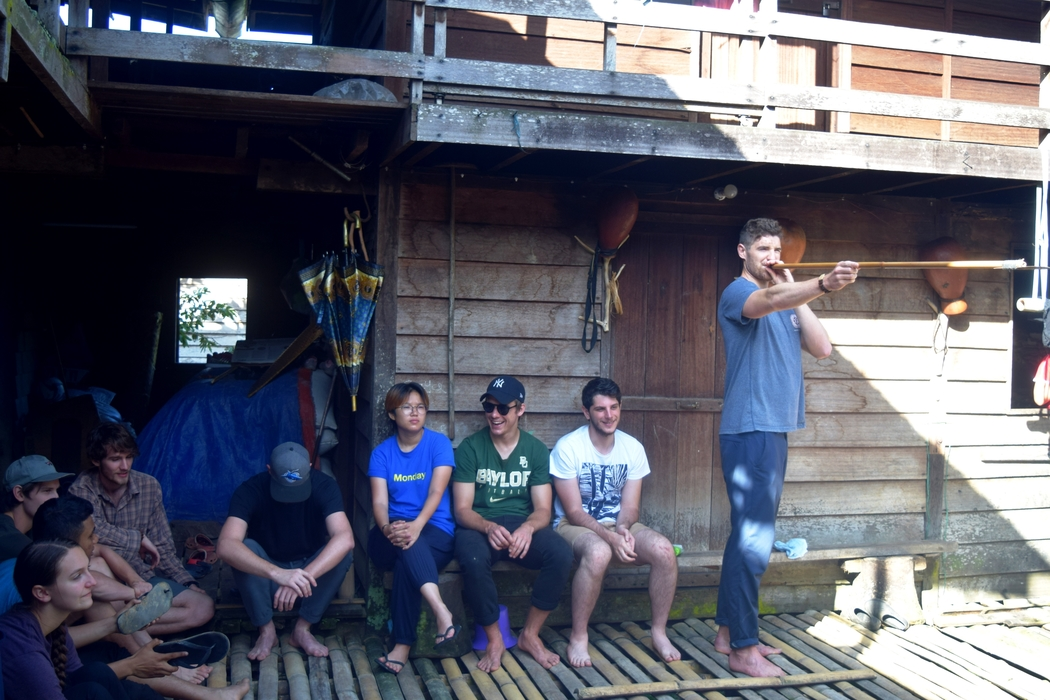 Playing blowpipe games during free times with Backyard Tour Malaysia