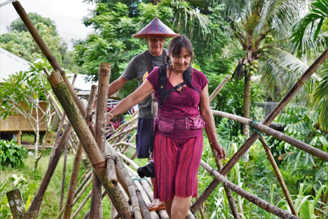 Walking around the village using the bamboo bridge with Backyard Tour Malaysia
