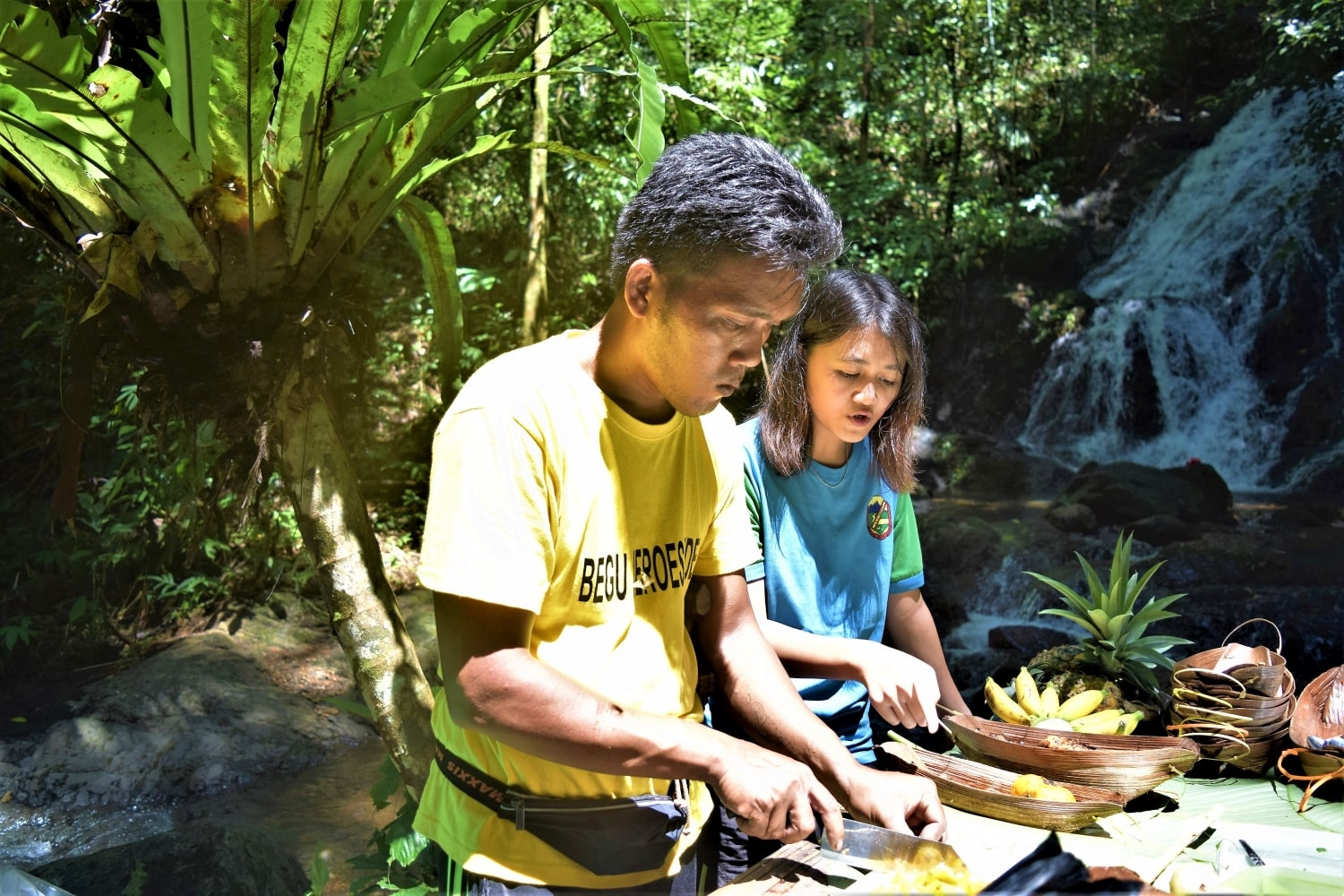 Cooking tribal food lunch at the waterfall in Begu Village, Kuching with Backyard Tour Malaysia