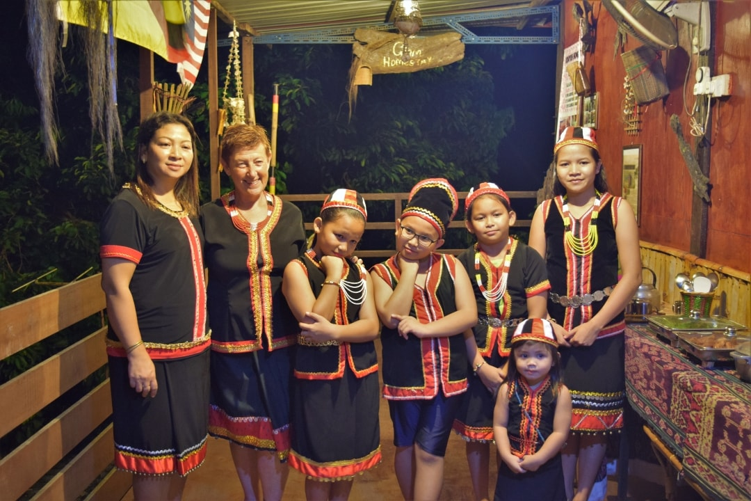 Trying out Bidayuh traditional costume (Madam Phyllis the host in the leftest)
