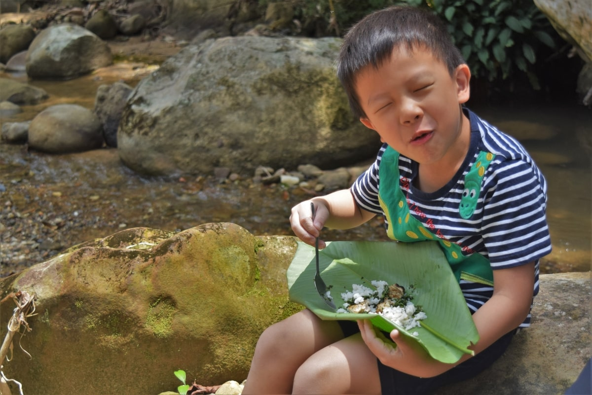 Kids would enjoy eating tribal barbequed food with Backyard Tour Malaysia